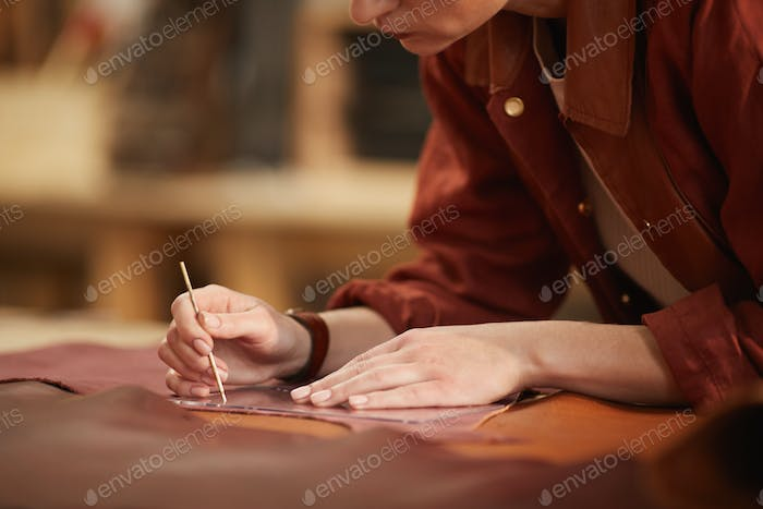 Woman Cutting Out Leather