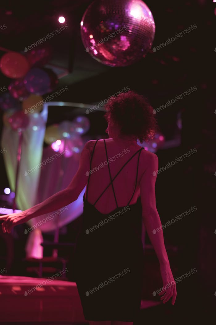 Woman on the dance floor of a club