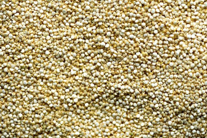 Roher Bio-Quinoa-Körner Hintergrund Textur. Hintergrund für Lebensmittelzutaten. Draufsicht, gesund