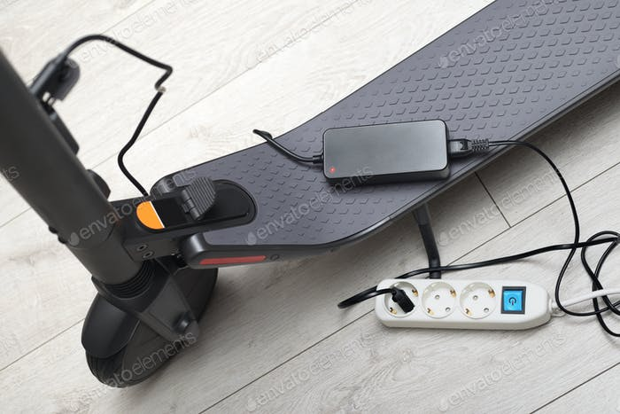 Battery charging process of electric motorized scooter.
