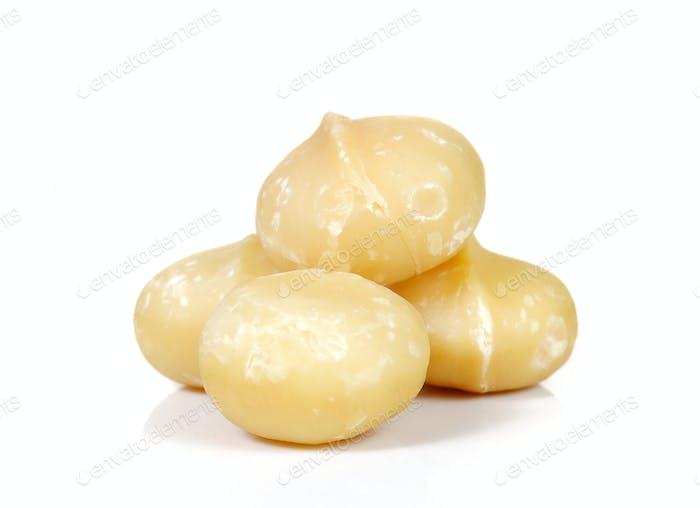 Macadamia on white background.Focus macadamia front.