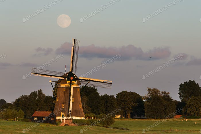 Full moon over a traditional windmill