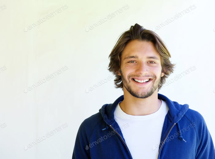 Happy handsome young man against white background