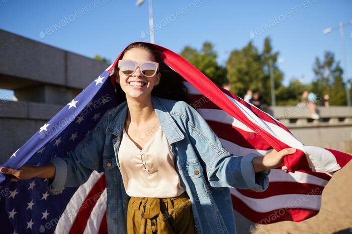 Ecstatic woman having fun on independence day