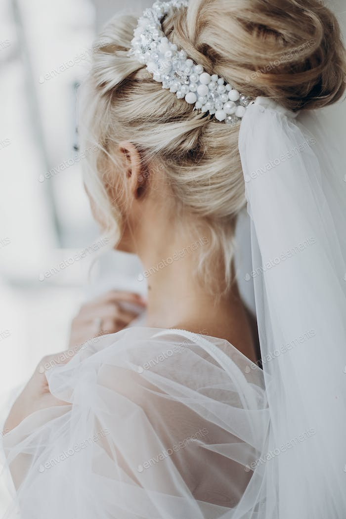 luxury beautiful bride hair style with pearl and veil, back view