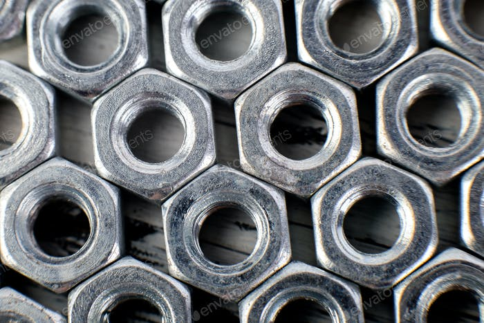 Metal nuts background. Macro. Working tools. Fixing elements.