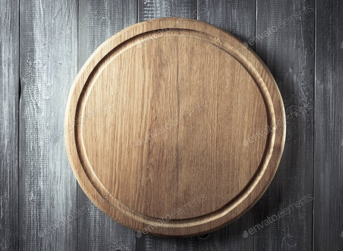 pizza cutting board at rustic background
