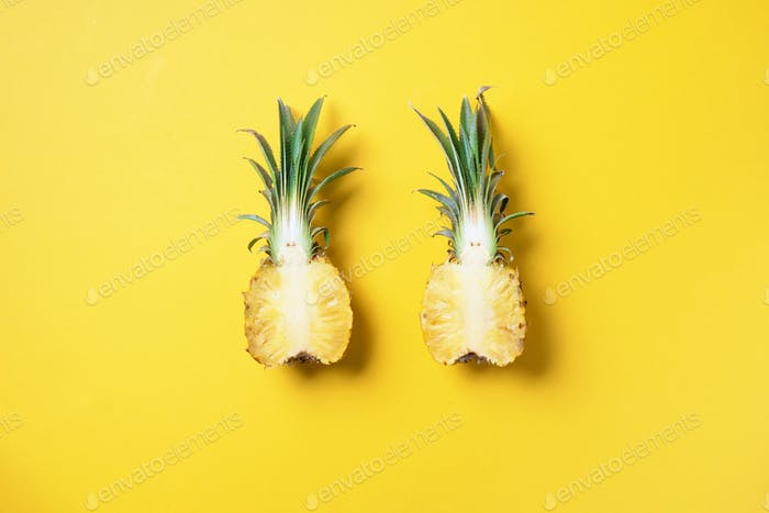 Creative layout made of pineapple on yellow background. Top view. Copy space. Flat lay. Exotic food