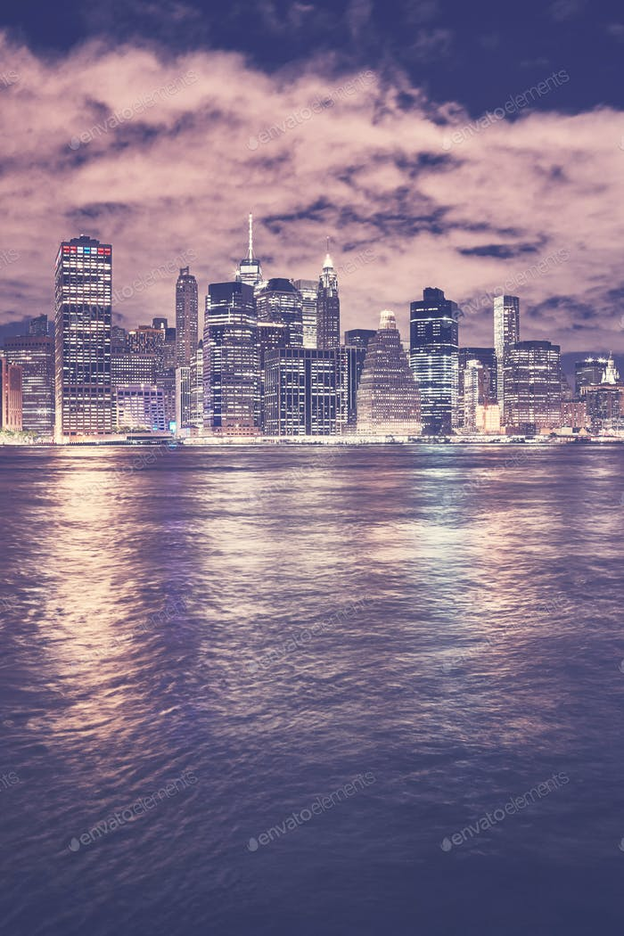 Vintage toned Manhattan skyline at night, New York.