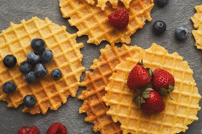 Round belgium waffles with berries