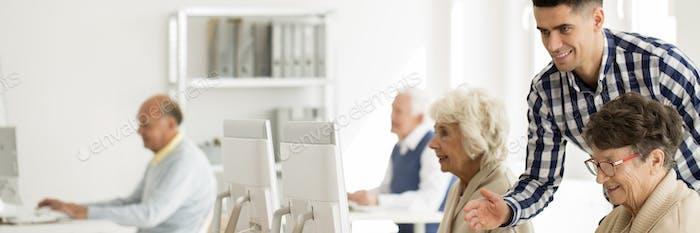 Explaining internet to elderly woman