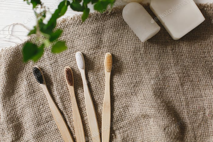 Eco natural bamboo toothbrushes on rustic background