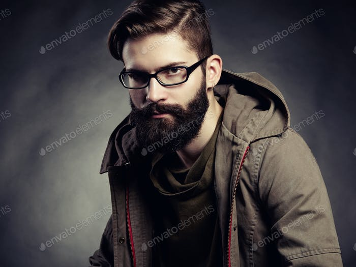Portrait of man with glasses and beard