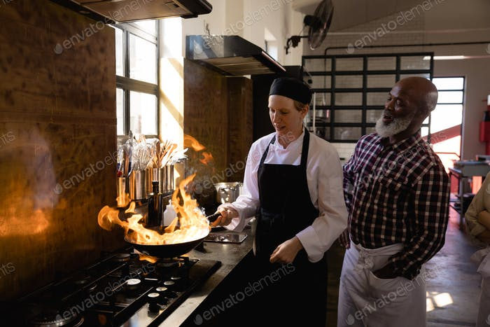 Chefs cooking with fire