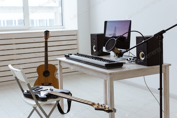 Microphone, computer and musical equipment guitars and piano background