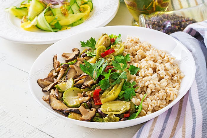Healthy vegetarian meal - mushrooms shiitake, zucchini  and oatmeal porridge