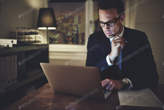 Thumbnail for Serious businessman working on laptop