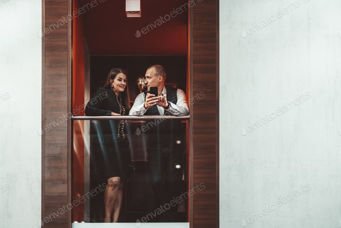 A dialog of a couple on a balcony
