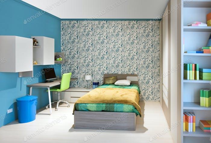 Ordentliche Teenager Schlafzimmer mit blauem Dekor