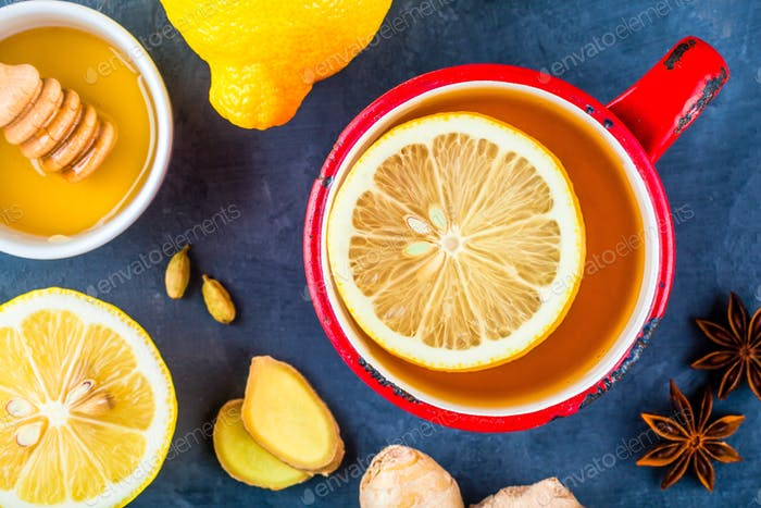 cup of tea with ginger, lemon, honey, anise and cardamom
