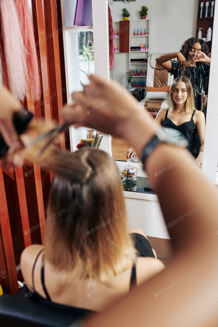 Young woman getting her hair cut