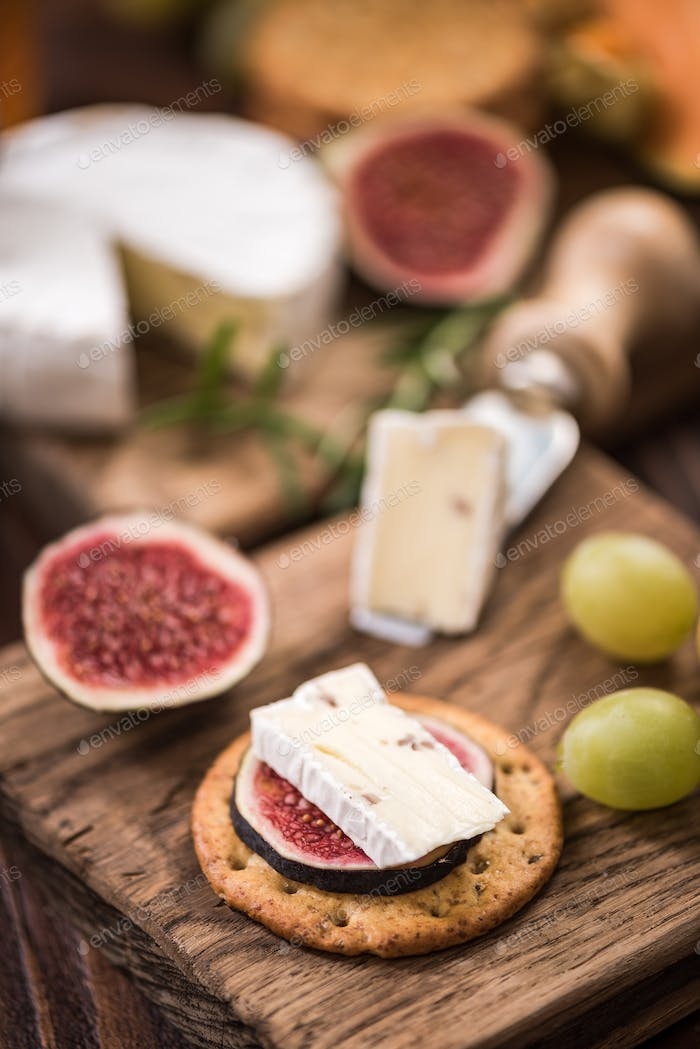 Cheese crackers with camembert and fresh fig