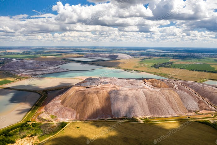 Salt mountains in the city of Soligorsk and turquoise artificial reservoir.Belarus