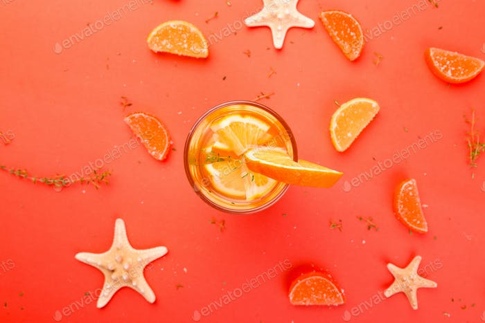 Orange fruit cocktail, detox water on orange background