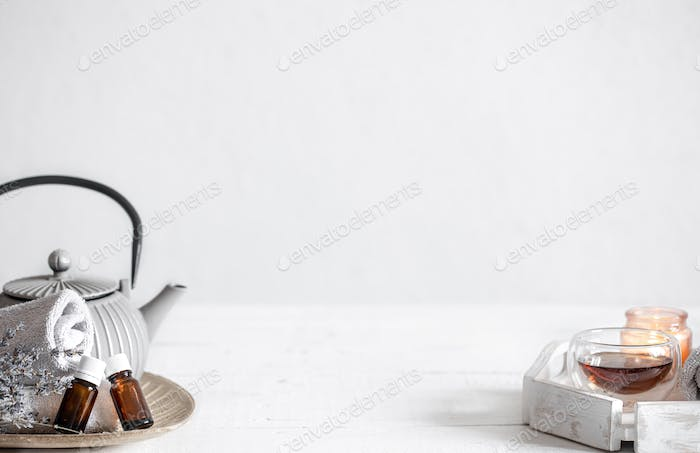 Composition with teapot, tea and natural aromatic oils copy space.