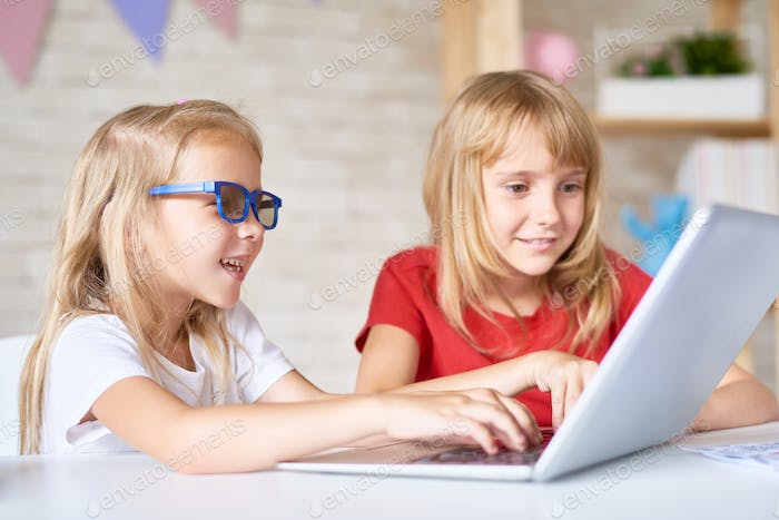 Little Sisters Using Laptop