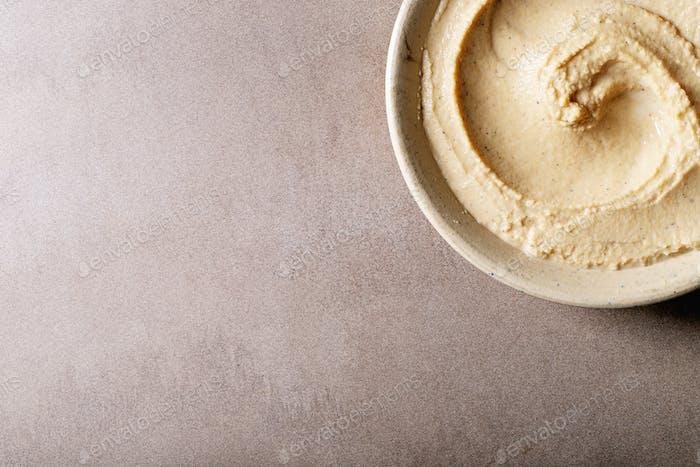 Hummus in ceramic bowl