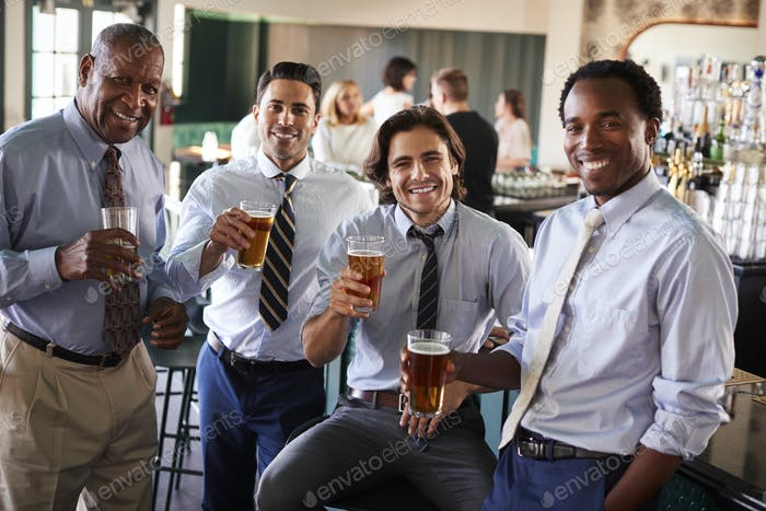 Portrait Of Businessmen Meeting For After Works Drinks In Bar