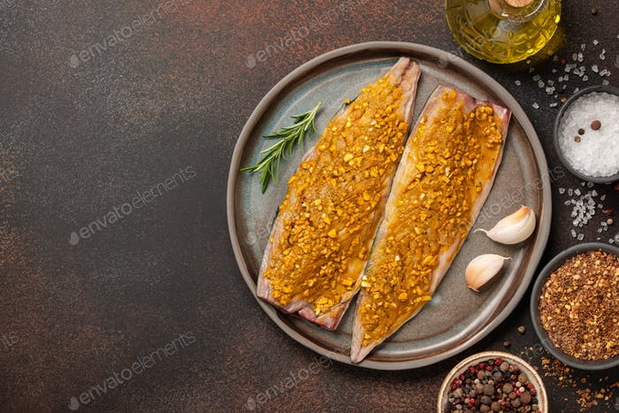 Marinated mackerel fish on ceramic plate and spices for cooking