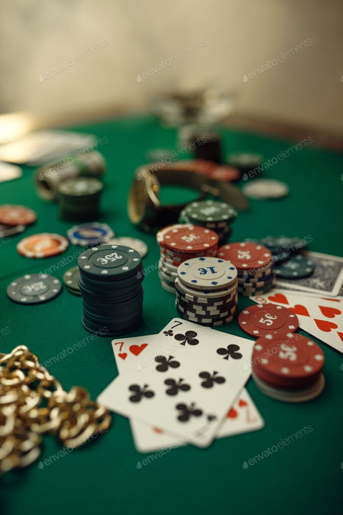 Poker concept, cards and chips closeup