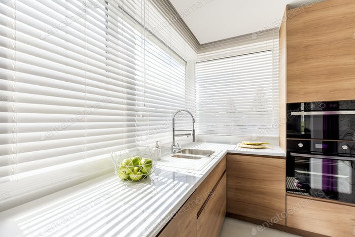 Kitchen with white window blinds