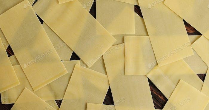 Heap of lasagna sheets on table