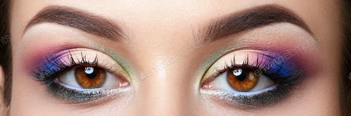 Closeup view of woman eyes with evening makeup