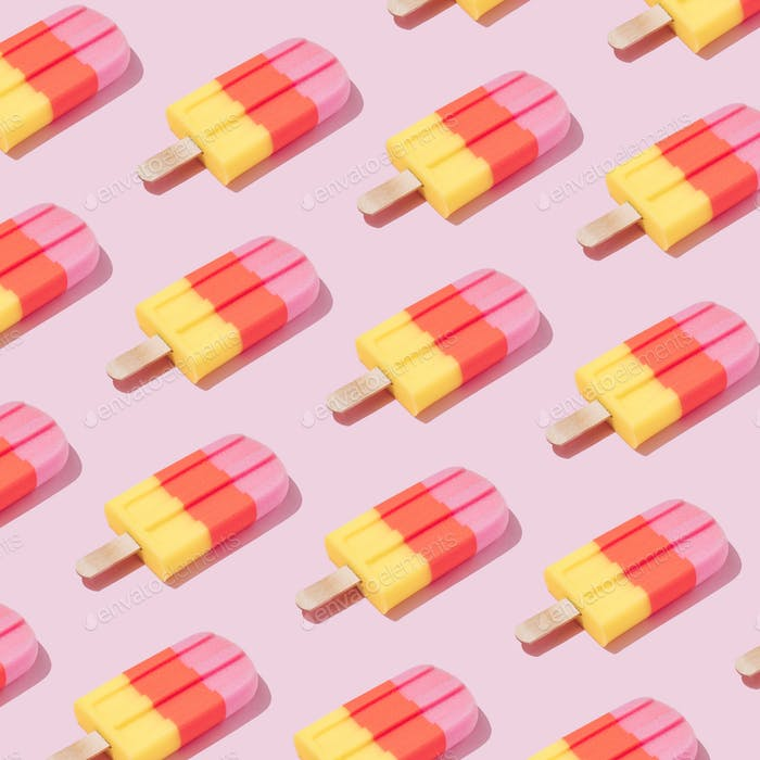Colorful Ice cream popsicle pattern on pastel pink background. Minimal summer concept. Flat lay.