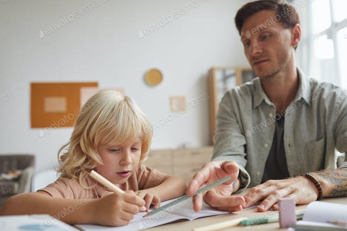 Teacher teaching the pupil