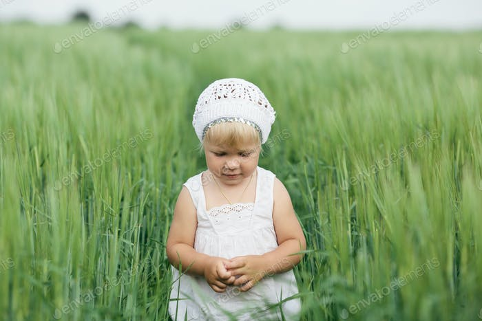 little girl in high grass
