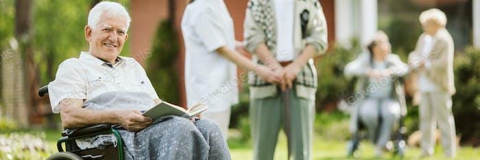 Elderly spending time in the nursing home garden