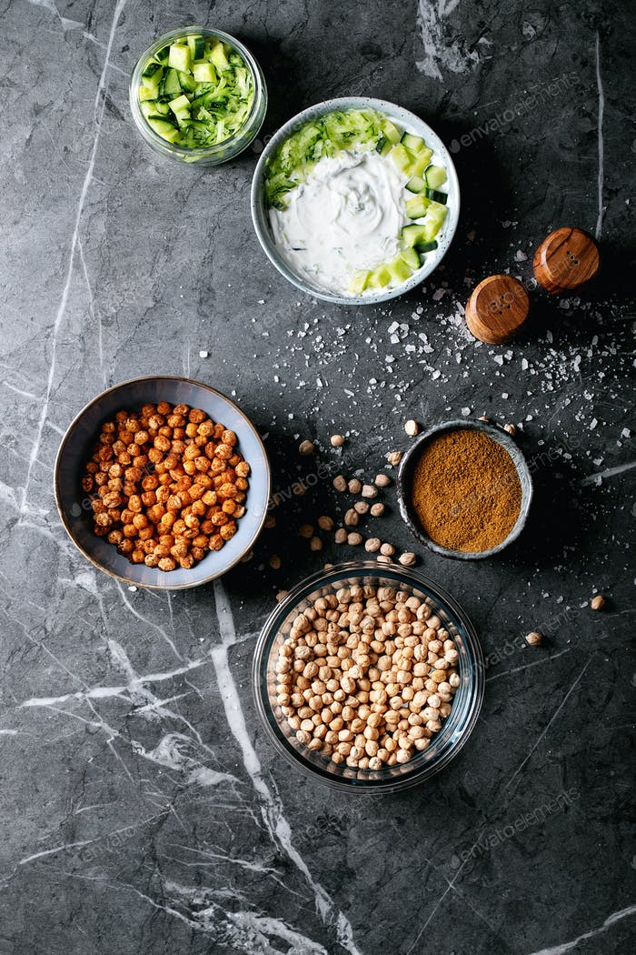 Tzatziki and chickpeas salat in ceramic bowl