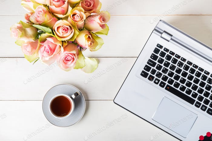 Feminine business mockup with laptop, roses bouquet and cup of c