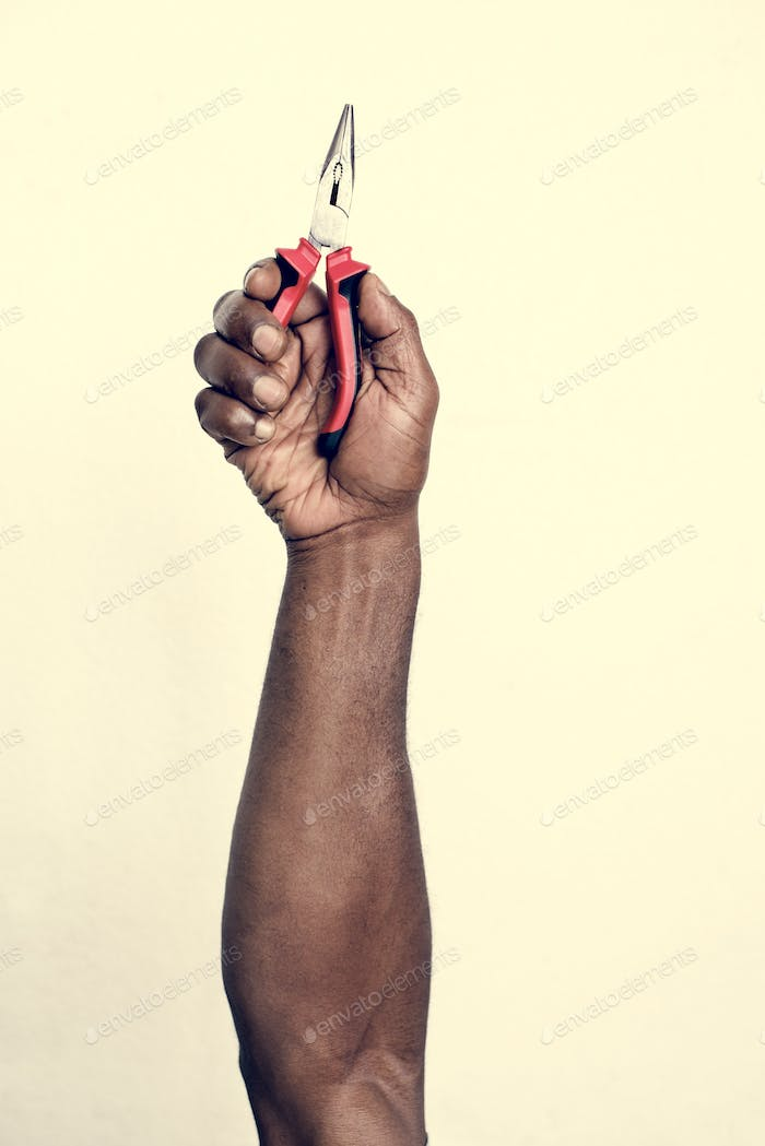 Hand holding equipment tool isolated on background