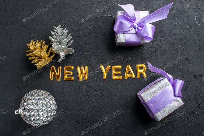 top view new year alphabet letters different xmas ornaments on dark background