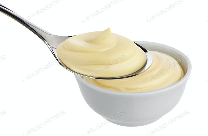 Mayonnaise in spoon isolated on white background