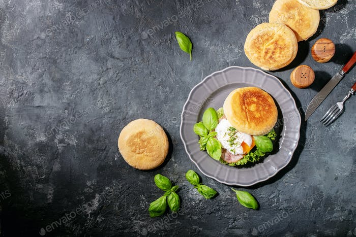Cooked egg benedict served with english muffins