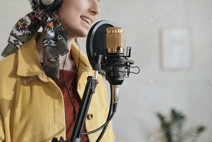 Woman recording a song