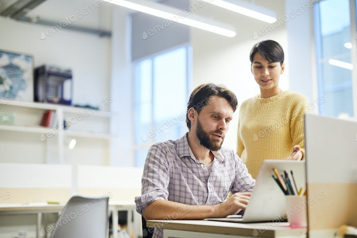 Lady expressing opinion while discussing project with colleague