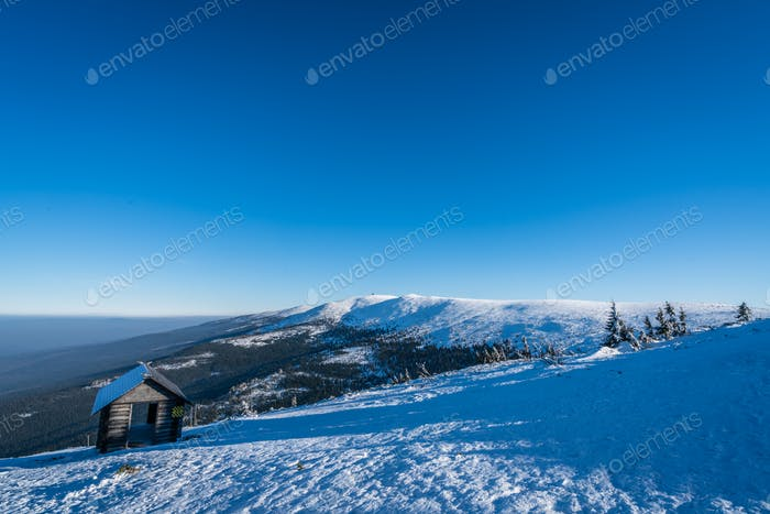 Small wooden hut on the slope of Szrenica mountain